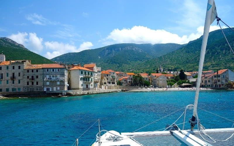 Komiza city catamaran charter Croatia Catamaran rent Croatia skippered yacht cruise sailboat multihull vessel sailing holidays Adriatic